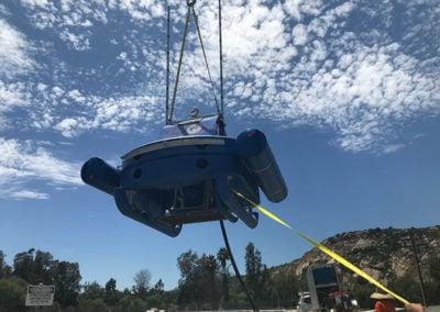 crane lowering dredge sled