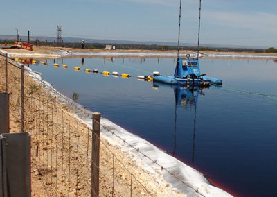 waste water lagoon being dredged by dredge sled