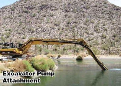 Long Arm excavator attachment cleaning irrigation canal in California