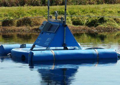 lagoon dredge equipment on surface of lagoon