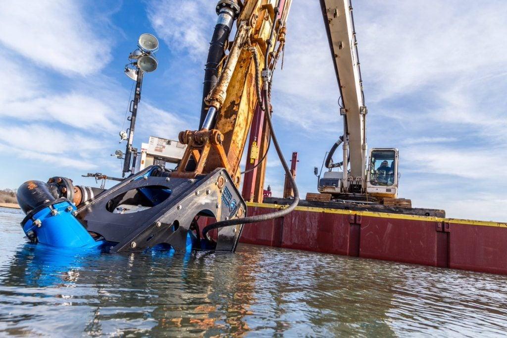 slurry hose connected to eddy pump dredging excavator attachment